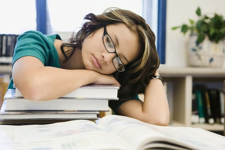 High School Student Sleeping on a Stack of Books Stock Photo - 12736828