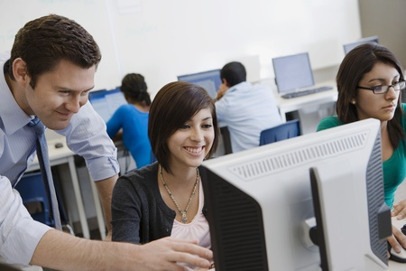 Teacher Helping Student in Computer Lab Stock Photo - 12736849