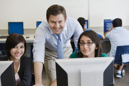 computer instruction: Teacher and Students in Computer Lab