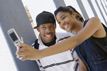 upper half: High School Couple Taking a Self Portrait