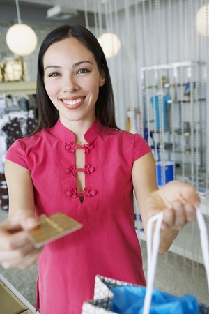 salesperson: Young Woman Making a Purchase LANG_EVOIMAGES