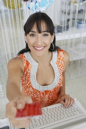 Saleswoman Handing Credit Card back to Customer Stock Photo - 12736879