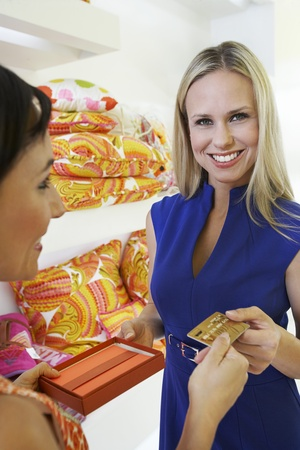 Young Woman Making a Purchase Stock Photo - 12736903