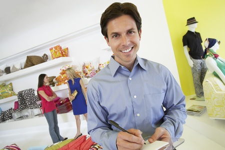 Man Signing a Receipt Stock Photo - 12736909