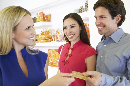Couple Making a Purchase Stock Photo - 12736916