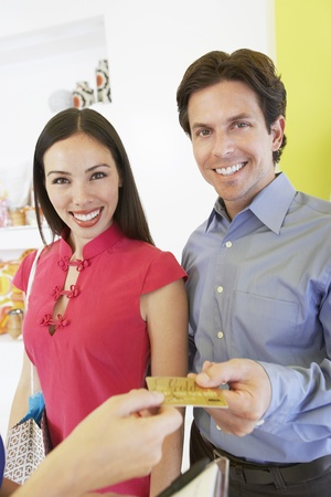 convenient store: Couple Making a Purchase