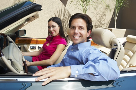 30 to 35 year olds: Couple Sitting in a Convertible LANG_EVOIMAGES