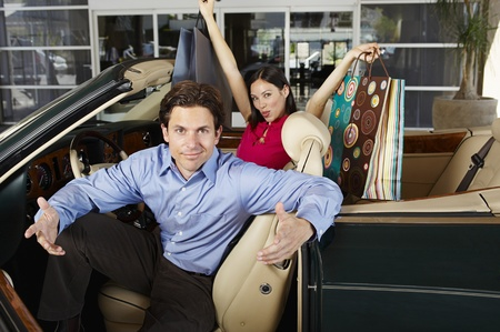 Couple in a Convertible Stock Photo - 12736987