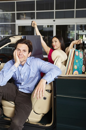 Couple Sitting in a Convertible Stock Photo