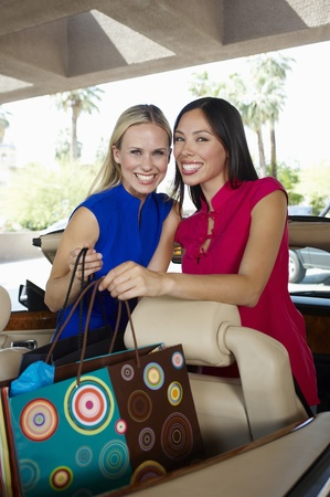 ethnic mixes: Women Sitting in a Convertible Holding Shopping Bags
