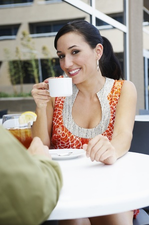 30 to 35 year olds: Woman on a Date in a Coffee Shop
