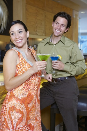 30 to 35 year olds: Couple Drinking Martinis