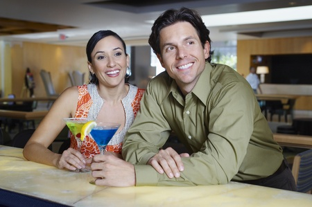 Couple Drinking Martinis at a Bar Stock Photo - 12737016