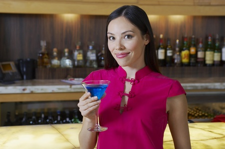 Woman Drinking a Blue Martini Stock Photo - 12737018