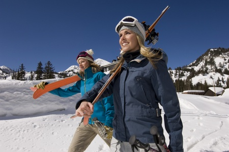 Skiers Carrying Skis on Mountain Stock Photo - 12737033