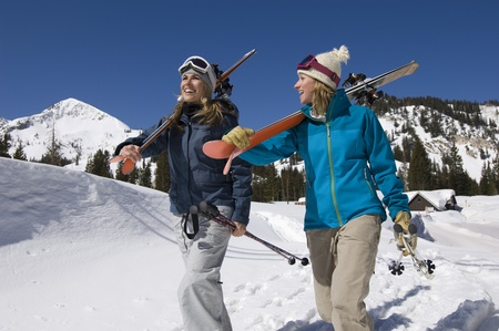 Skiers Carrying Skis on Mountain Stock Photo - 12737034