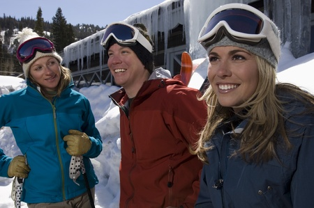 age 25 30 years: Three Skiers at Ski Resort LANG_EVOIMAGES