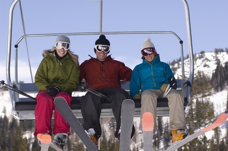 chair lift: Three Skiers on Chair Lift
