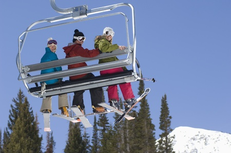 Three Skiers on Chair Lift Stock Photo - 12737042
