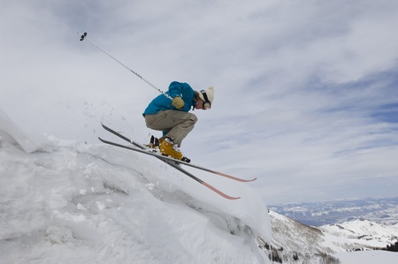 25 to 30 year olds: Skier Jumping Off Icy Overhang
