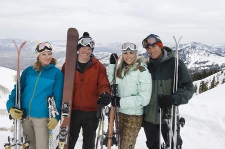 Skiers Holding Skis on Mountain Stock Photo - 12737048