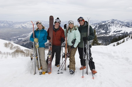 Skiers Holding Skis on Mountain Stock Photo - 12737049