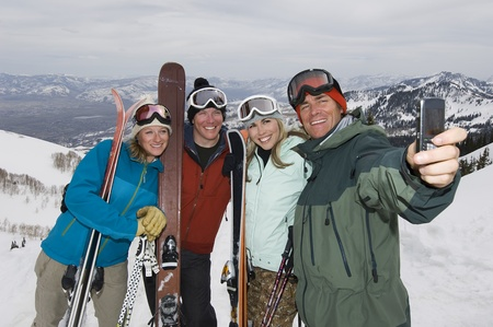 athletic gear: Skiers Taking Their Picture With Cell Phone