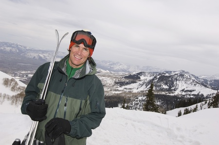 age 30 35 years: Skier Holding Skis on Mountain