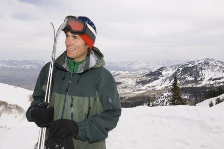 Skier Holding Skis on Mountain Stock Photo - 12737052