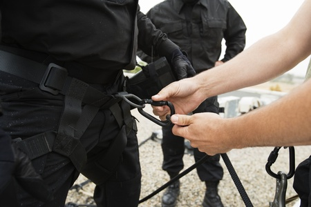 abseiling: SWAT Team Preparing Climbing Equipment