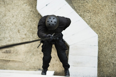 age 35 40 years: SWAT Team Officer Rappelling from Building