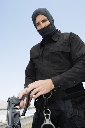 35 to 40 year olds: SWAT Team Officer with Automatic Pistol