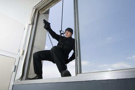 SWAT Team Officer Hanging from Window Stock Photo - 12737080