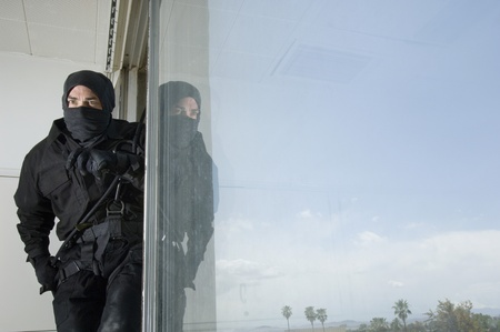 SWAT Team Officer in Window Stock Photo - 12737082