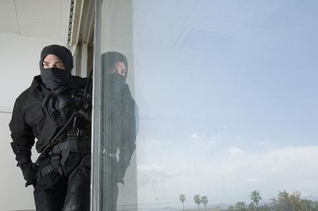 swat teams: SWAT Team Officer in Window