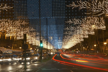 action blur: Traffic Light Trails on Decorated Street