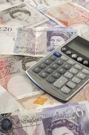 British paper currency and calculator Stock Photo - 12737114