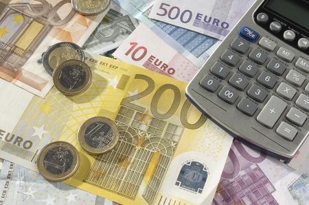 Money and Calculator Stock Photo - 12737116