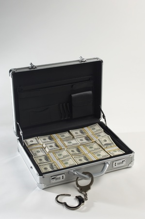 handcuffing: Briefcase Full of Money