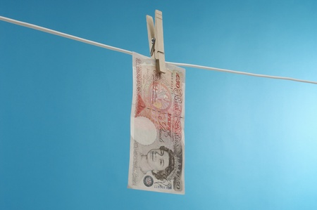 British paper currency on clothesline Stock Photo - 12737135