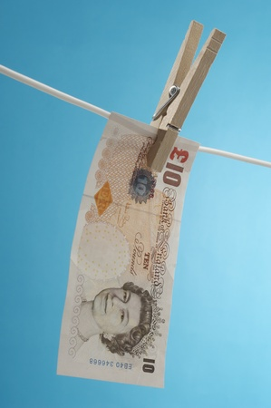 British paper currency on clothesline Stock Photo - 12737136