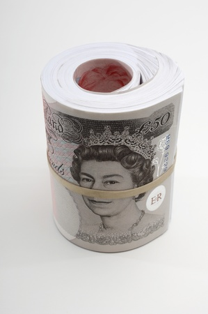 Roll of British paper currency Stock Photo - 12737146