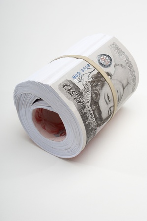 Roll of British paper currency Stock Photo - 12737147