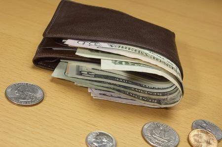 Portefeuille vol geld Stockfoto