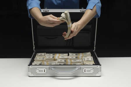 Briefcase Full of Money Stock Photo - 12737192
