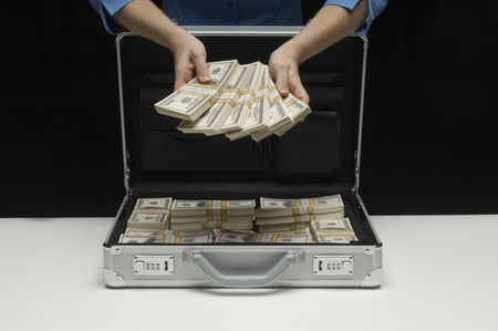 Briefcase Full of Money Stock Photo - 12737193