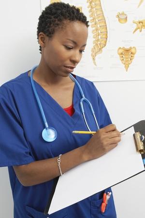 writing activity: Female nurse working in hospital
