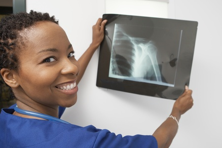 Doctor holding x-ray in hospitalportrait Stock Photo - 12737212
