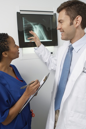 Doctor and nurse examining x-ray in hospital Stock Photo - 12737223
