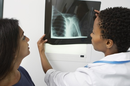 unknown age: Patient and female doctor examining x-ray